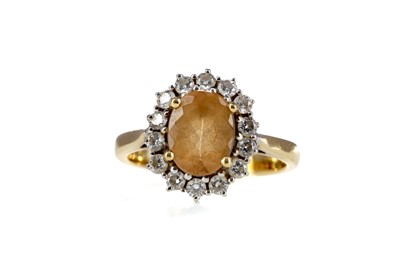 Lot 874 - AN IMPERIAL TOPAZ AND DIAMOND CLUSTER RING
