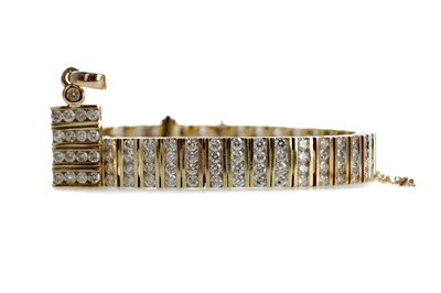 Lot 829 - A DIAMOND FOUR ROW BRACELET AND MATCHING PENDANT