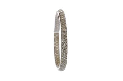 Lot 924 - A SINGLE DIAMOND HOOP EARRING