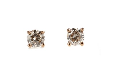 Lot 858 - A PAIR OF DIAMOND STUD EARRINGS