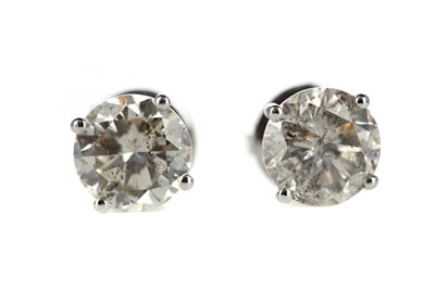 Lot 870 - A PAIR OF DIAMOND STUD EARRINGS