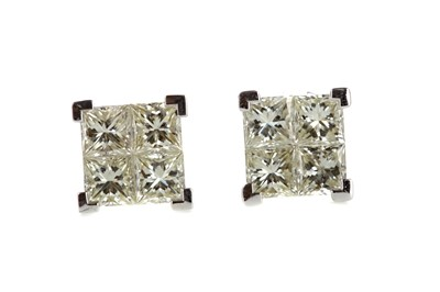 Lot 873 - A PAIR OF DIAMOND QUAD EARRINGS