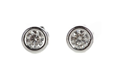 Lot 883 - A PAIR OF DIAMOND STUD EARRINGS