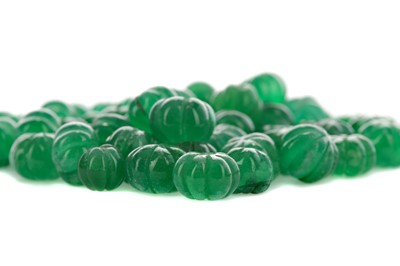 Lot 885 - A COLLECTION OF CARVED EMERALD BEADS