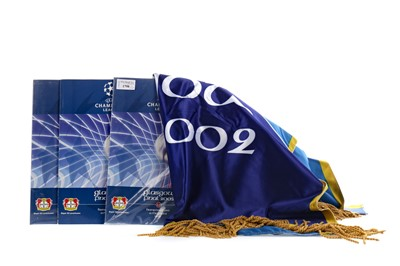 Lot 1798 - AN OFFICIAL BANNER FROM THE 2002 CHAMPIONS LEAGUE FINAL, ALONG WITH THREE PROGRAMMES
