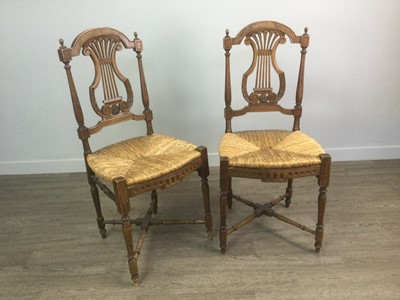 Lot 1406 - A PAIR OF FRENCH WALNUT LYRE BACK SINGLE CHAIRS