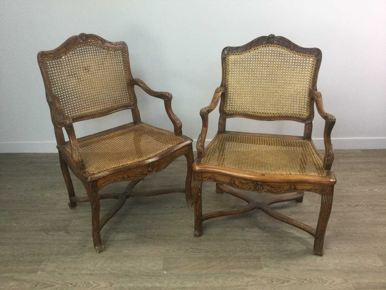 Lot 1407 - A PAIR OF 19TH CENTURY FRENCH PROVINCIAL WALNUT OPEN ELBOW CHAIRS