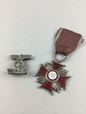 Lot 93 - A POLISH ORDER OF MERIT MEDAL ALONG WITH A THIRD REICH BADGE
