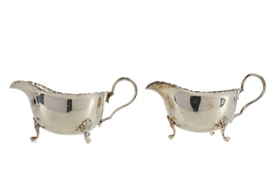 Lot 459 - A PAIR OF EARLY 20TH CENTURY SILVER SAUCE BOATS