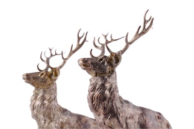 Lot A LOT OF TWO CAST SILVER STAG TABLE ORNAMENTS