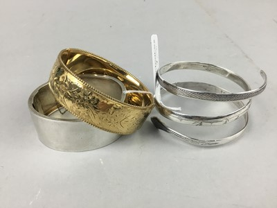Lot 7 - A VICTORIAN SILVER BANGLE AND TWO OTHERS