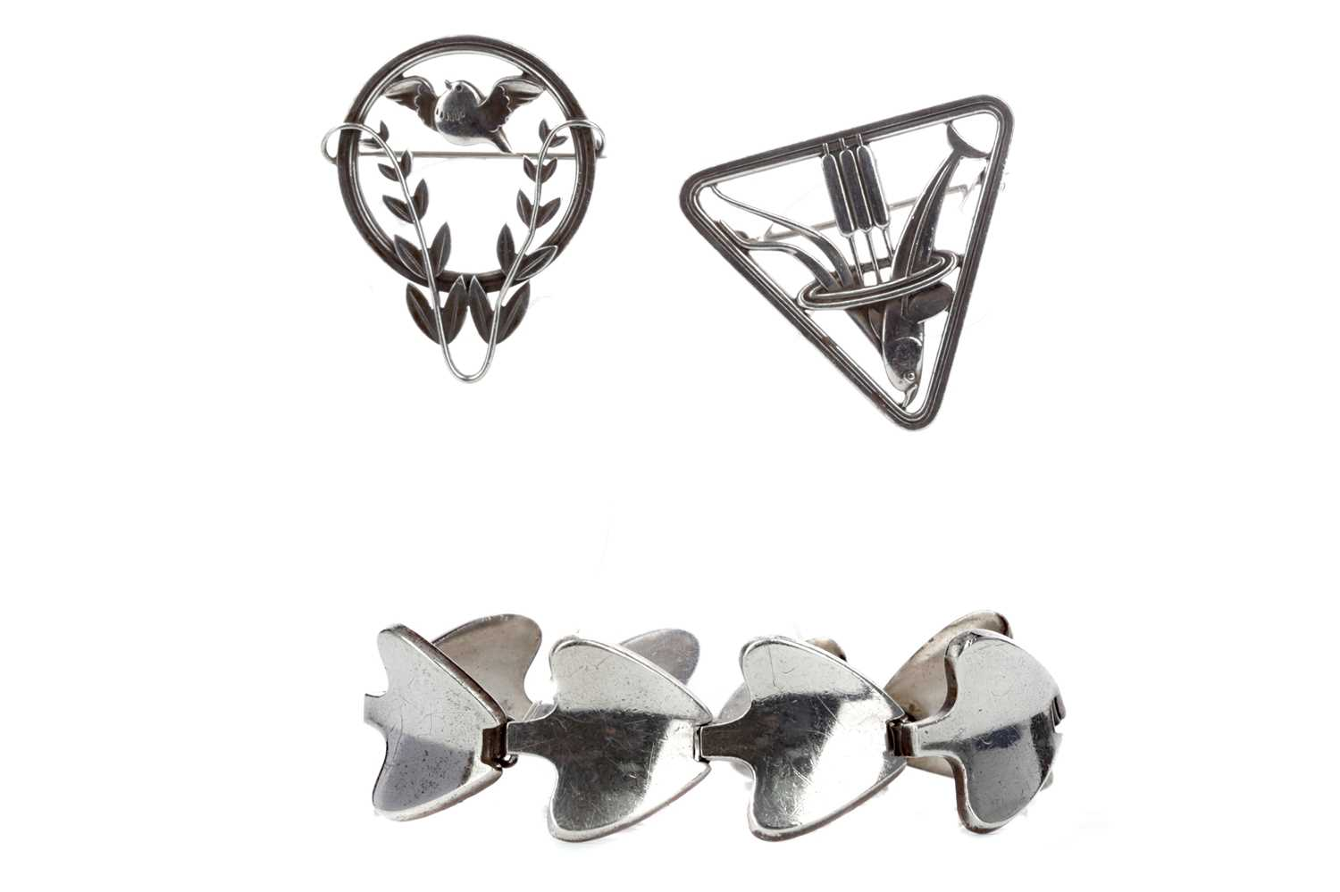Lot 329 - TWO GEORG JENSEN SILVER BROOCHES AND A BRACELET