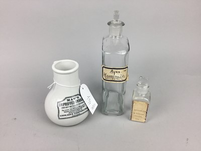 Lot 40 - A GLASS PHARMACEUTICAL BOTTLE AND TWO OTHERS