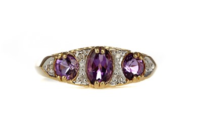 Lot 420 - AN AMETHYST AND DIAMOND RING