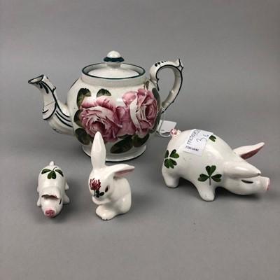 Lot 3 - A WEMYSS TEA POT, A PLICKTA RABBIT AND TWO PIGS