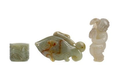 Lot 836 - A 20TH CENTURY CHINESE JADE ARCHER'S RING, FISH AND MALE CARVINGS