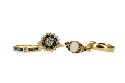 Lot 471 - A SAPPHIRE AND DIAMOND CLUSTER RING ALONG WITH THREE OTHERS