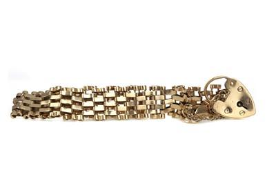 Lot 472 - A NINE CARAT GOLD GATELINK BRACELET
