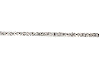 Lot 1396 - A DIAMOND TENNIS BRACELET