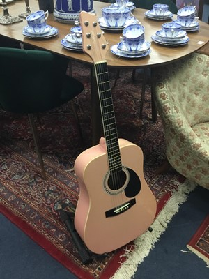Lot 40A - A CHILD'S PINK ACOUSTIC GUITAR ON STAND