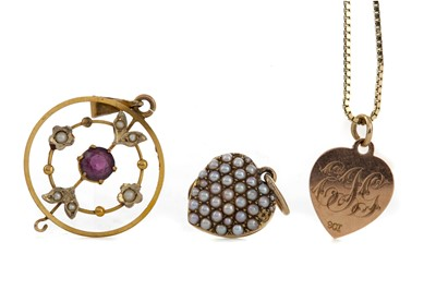 Lot 1314 - TWO HEART PENDANTS AND AN AMETHYST AND SEED PEARL PENDANT