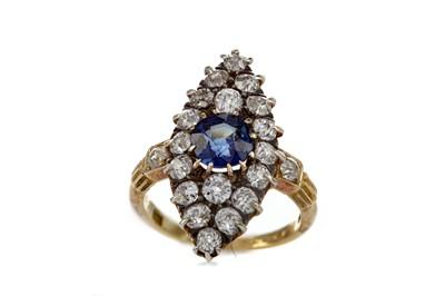 Lot 1317 - A BLUE GEM SET DIAMOND RING