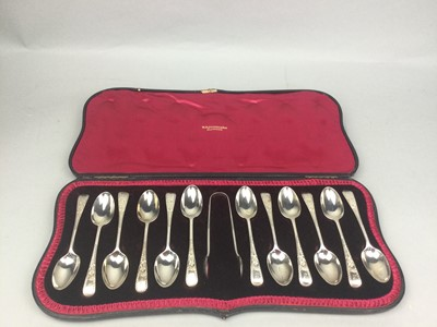 Lot 62 - A CASED SET OF TWELVE SILVER SPOONS AND TONGS