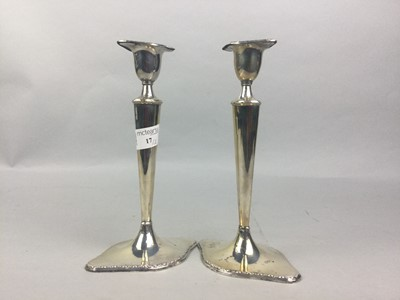 Lot 17 - A PAIR OF SILVER CANDLESTICKS
