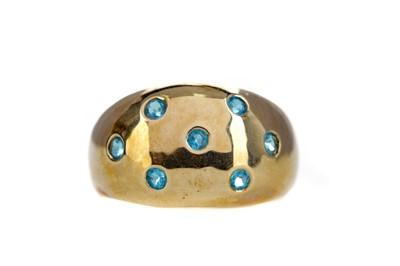 Lot 1354 - A BLUE GEM SET RING