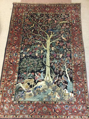 Lot 912 - A KIRMAN TREE OF LIFE BORDERED RUG