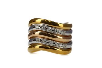 Lot 1362 - A DIAMOND WAVE RING