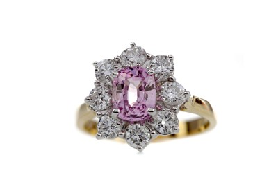 Lot 1441 - A PINK SAPPHIRE AND DIAMOND RING