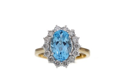 Lot 1454 - A BLUE TOPAZ AND DIAMOND CLUSTER RING