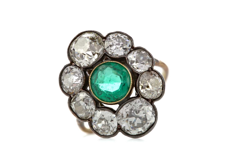 Lot 1371 - AN IMPRESSIVE EMERALD AND DIAMOND RING
