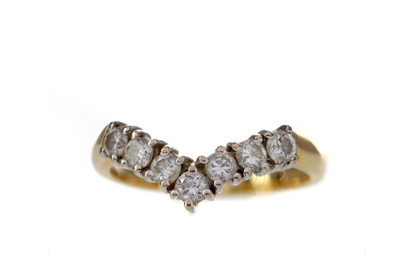 Lot 843 - A DIAMOND WISHBONE RING