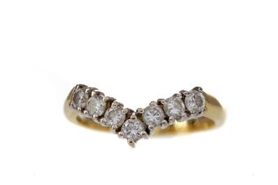 Lot 1380 - A DIAMOND WISHBONE RING
