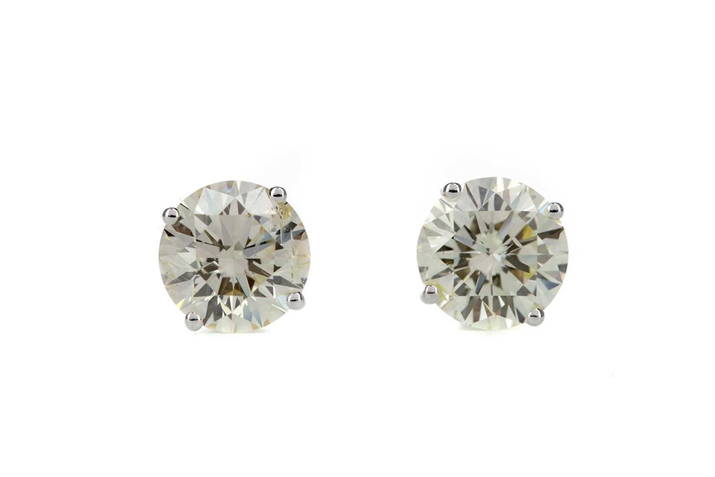 Lot 848 - A PAIR OF IMPRESSIVE DIAMOND STUD EARRINGS