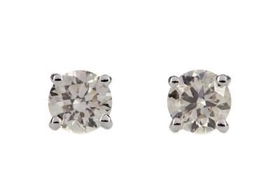 Lot 854 - A PAIR OF DIAMOND STUD EARRINGS