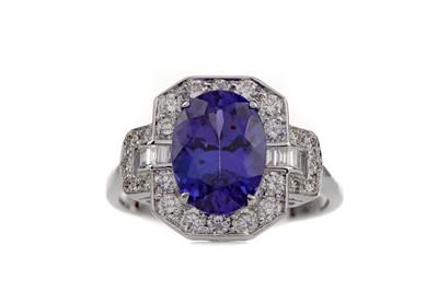 Lot 855 - A TANZANITE AND DIAMOND RING