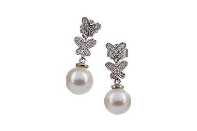 Lot 863 - A PAIR OF PEARL AND DIAMOND EARRINGS