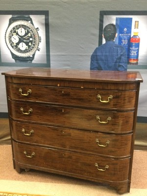 Lot 1687 - AN EARLY 20TH CENTURY MAHOGANY BARREL FRONTED CHEST OF DRAWERS