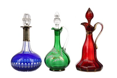 Lot 1083 - A BLUE GLASS DECANTER AND TWO OTHERS