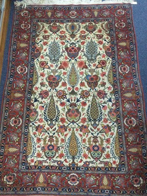 Lot 932 - A CAUCASIAN BORDERED RUG