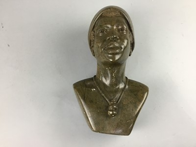 Lot 40 - AN AFRICAN CARVED HARDSTONE BUST OF A WOMAN
