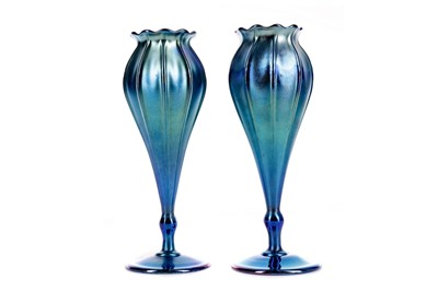 Lot 1050 - A PAIR OF L. C. TIFFANY BLUE FAVRILE VASES