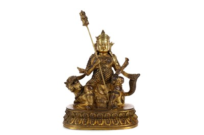 Lot 693 - A CHINESE BRONZE FIGURE OF A DEITY