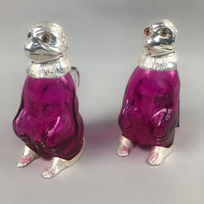 Lot 19 - A PAIR OF BIRD FORMED DECANTERS