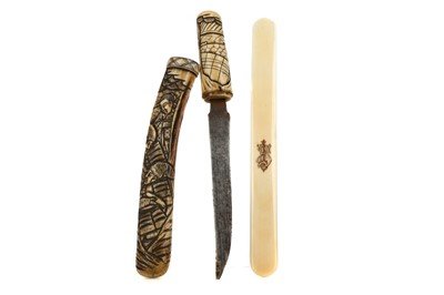 Lot 650 - AN EARLY 20TH CENTURY JAPANESE IVORY TANTO AND AN IVORY PAGE TURNER