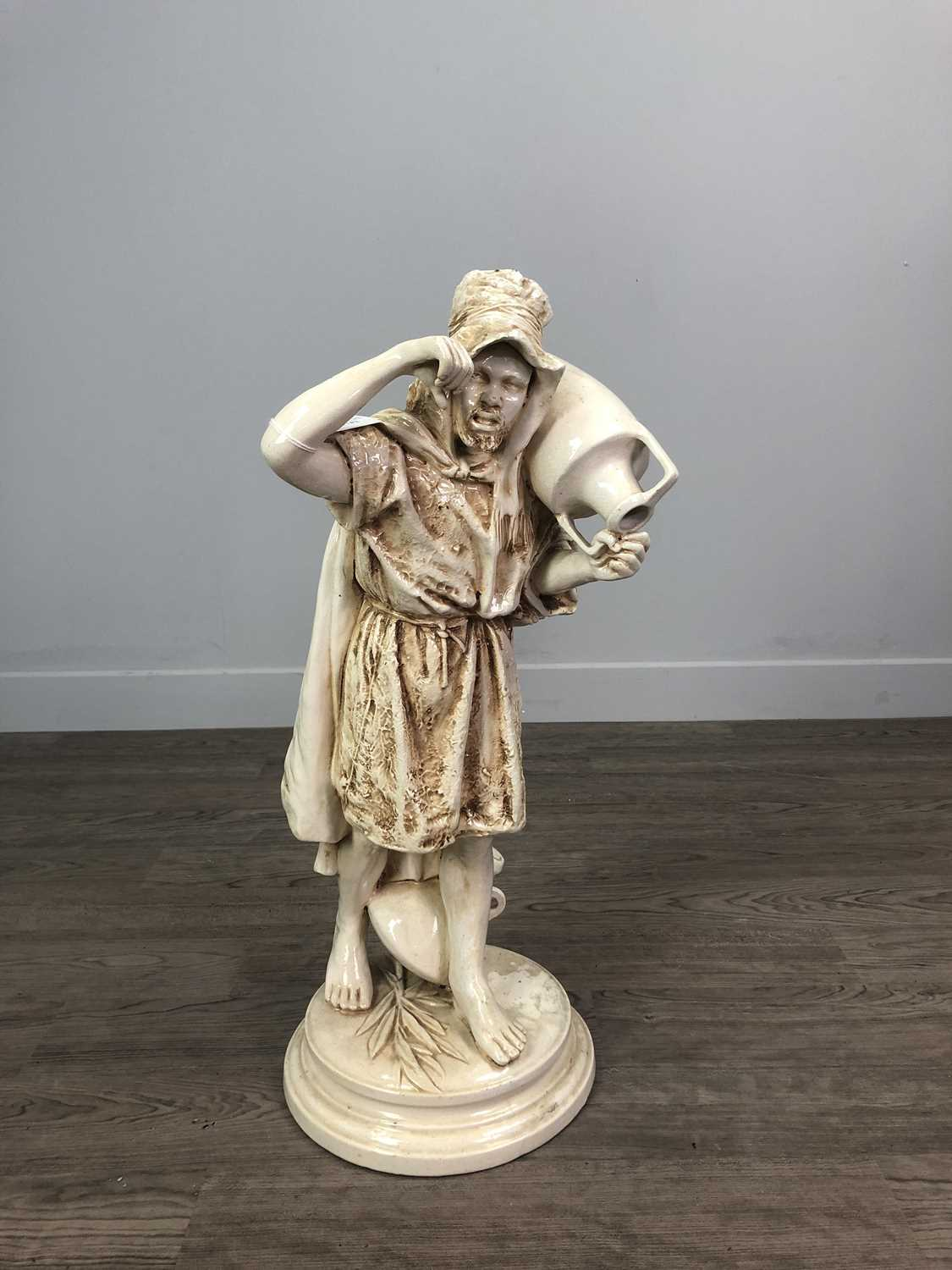 Lot 755 - A 20TH CENTURY POTTERY FIGURE OF A MAN WITH AMPHORA