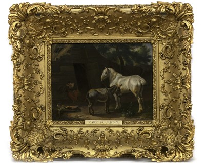 Lot 98 - A HORSE, DONKEY AND A LADY BEFORE A COUNTRY COTTAGE, AN OIL ATTRIBUTED TO KAREL DU JARDIN